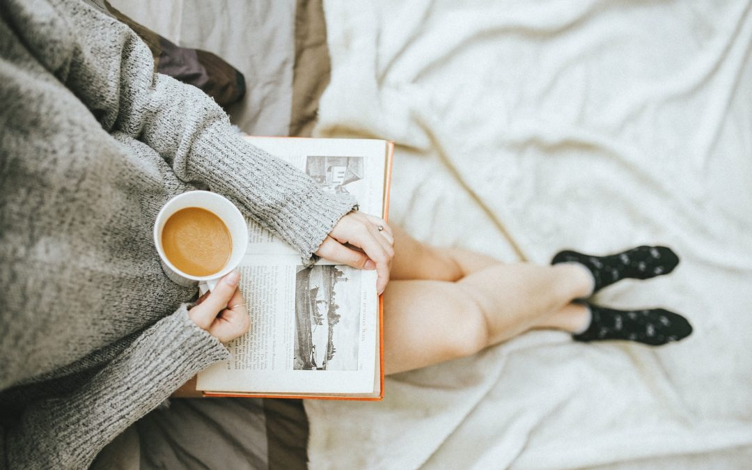 reading a book with a coffee